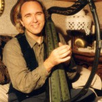 John Doan with a celtic harp