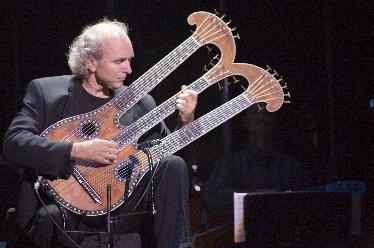 john doan Primal Twang Harpolyre- Photo, Erin Fitzgerald Taylor Guitars
