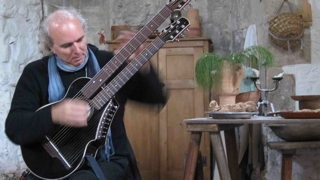 john doan playing harp guitar in England.