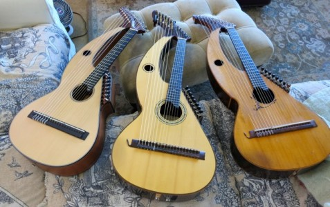 Three harp guitars.